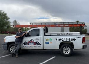 Project Manager Ian Simon posing with his newly decaled Hennessey Roofing Truck