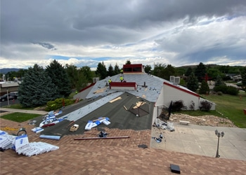 Construction underway for a commercial roofing project in Colorado Springs