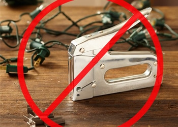 Image illustrating that a Staple Gun for Christmas Lights Can Damage Your Roof