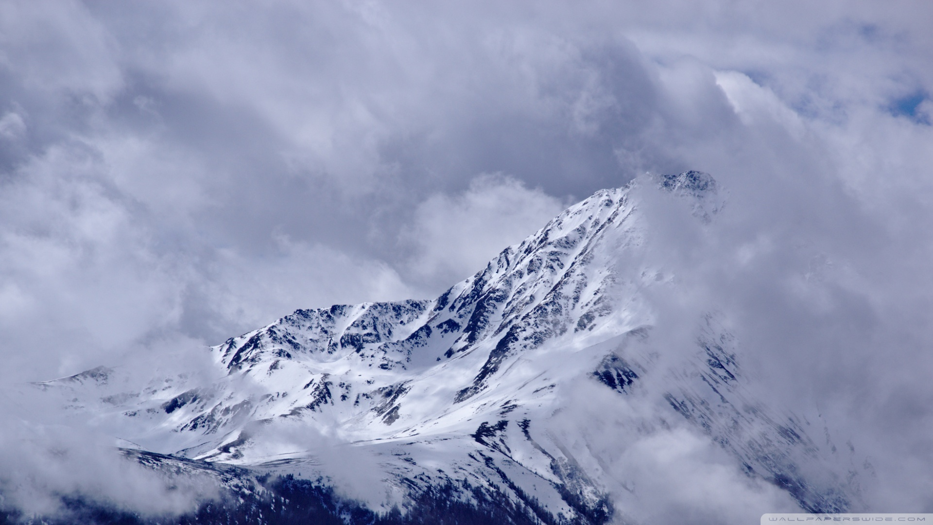 Download Free WallpaperMountain Peak With Drifting Clouds