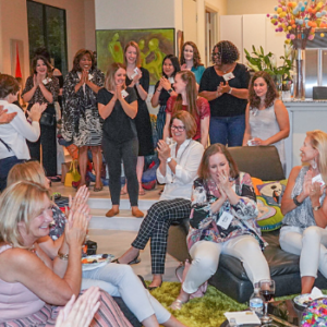 This image is of the Great Girls Network August 2019 Summer gathering. Picture of a large group of ladies clapping and cheering