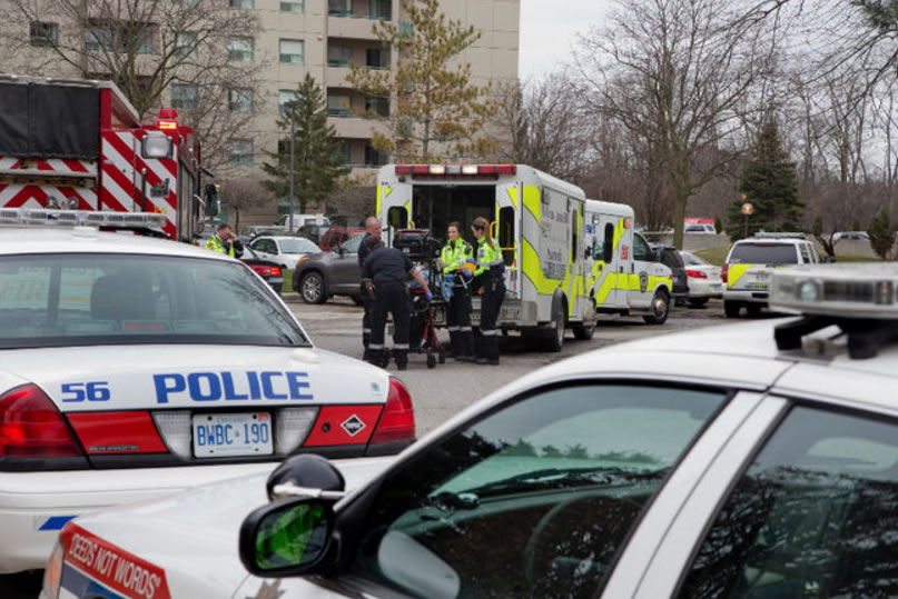 Police, firefighters and paramedics responded to reports of a drowning in the indoor swimming pool at 744 Proudfoot Lane in London, Ont. on Friday March 25, 2016. (DEREK RUTTAN, The London Free Press)