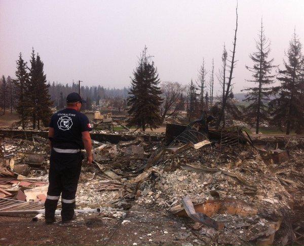 Firefighter Randy Evans surveys the damage in Fort McMurray