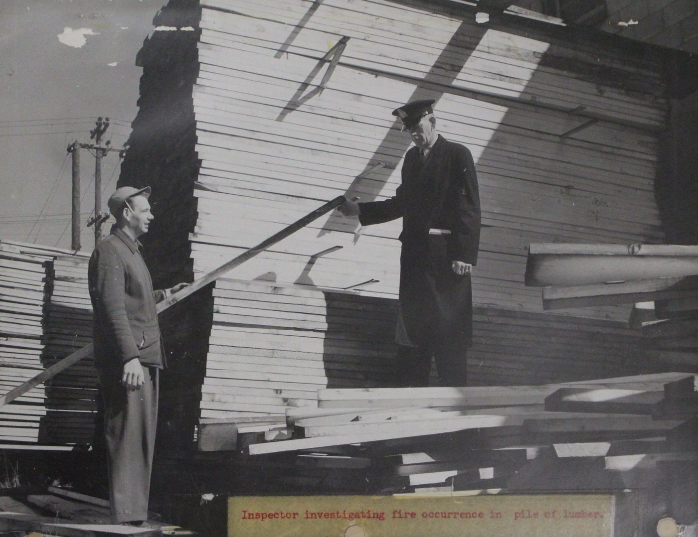 Fire Prevention Officer investigating a fire in a lumber yard