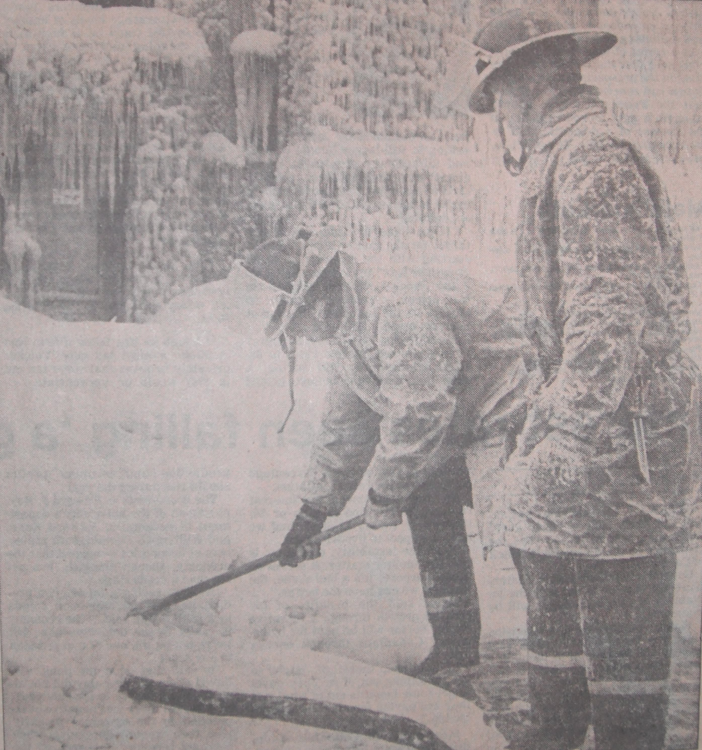 Firefighters chopping hoses out of ice.