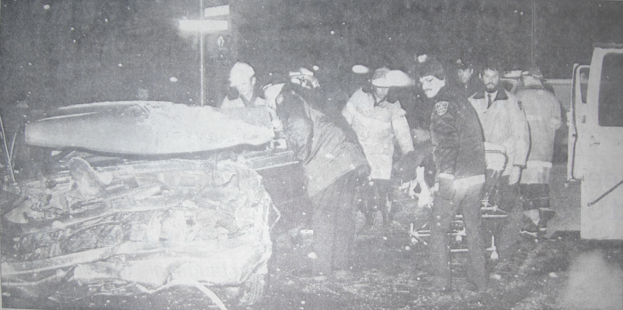 Fire, EMS and Police personnel working to free trapped persons from wreckage.