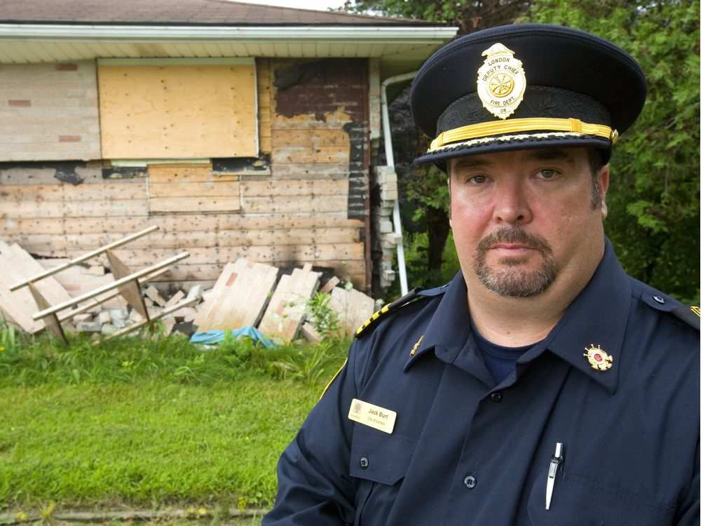 Acting deputy fire chief Jack Burt shows how a December butane THC-extraction blast blew the bricks off the walls of this Hamilton Road home.