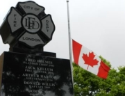 London Fire Fighters Memorial and flag at half staff.