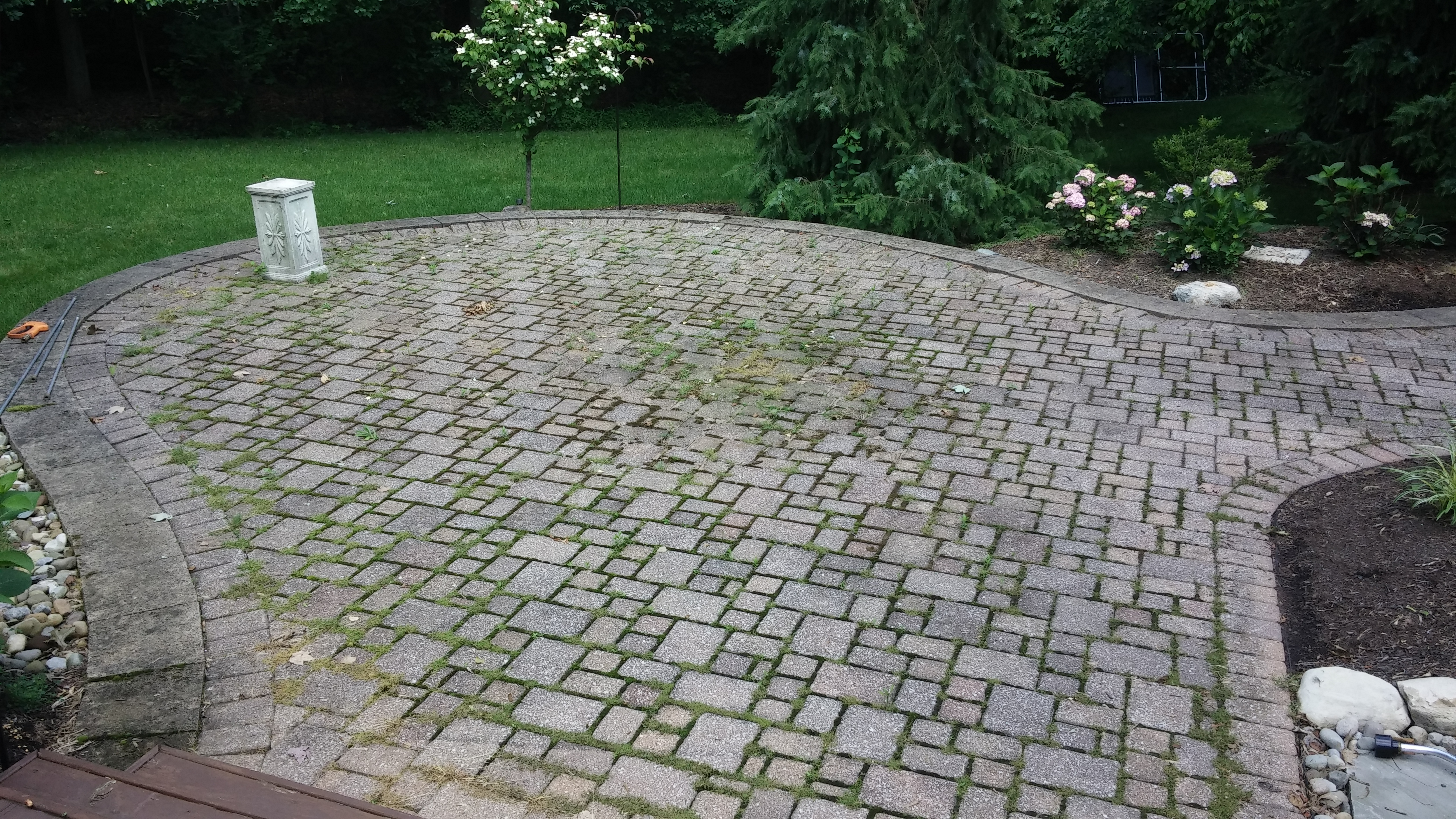 Before - Rear Brick Paver Patio in N. Olmsted Pressure Washing