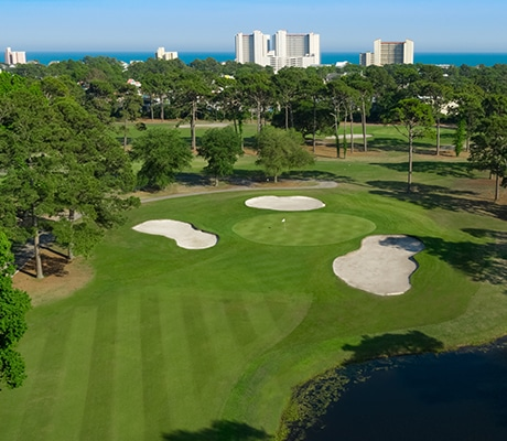 Beautiful shot of hole 8 at Beachwood Golf Club with North Myrtle Beach and hotels in background