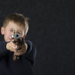 six year old with gun