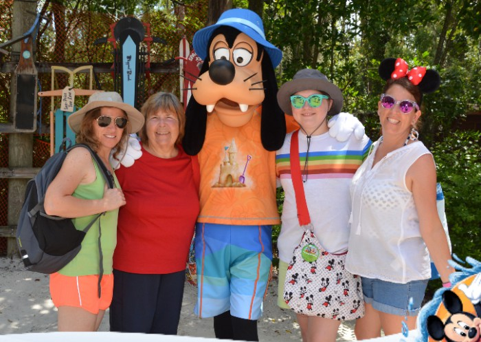 family with Goofy on vacation at Disney world