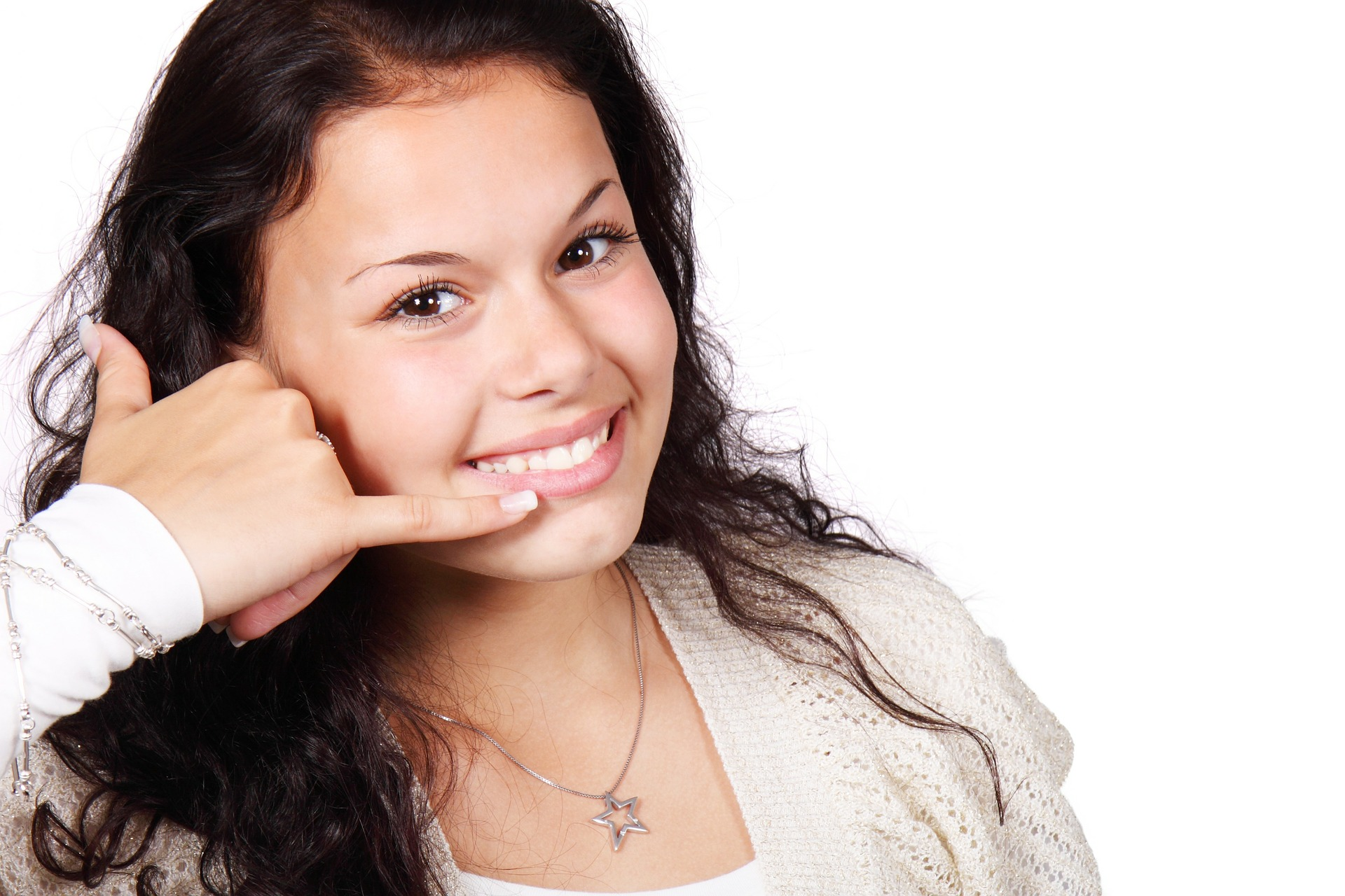 Girl making a phone gesture with her hand