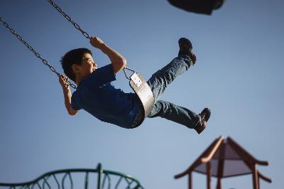 happy boy on swing