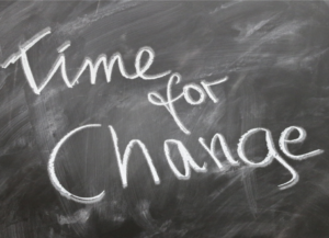 blackboard with time for change written in chalk