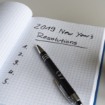 Notebook with 2019 New Year's Resolutions written on the pages
