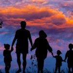 silouette of family of five walking at sunset