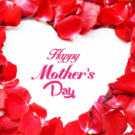 Flower petals in shape of heart with happy Mother's Day written in middle