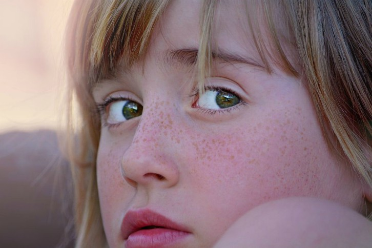 child with freckles