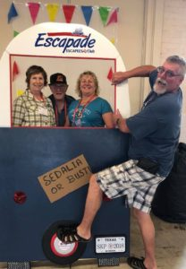 From left, Connie Farley, Jim McEver, and Dee Dee Sparks make tracks while Tony Sparks hangs on at the 58th Escapade.