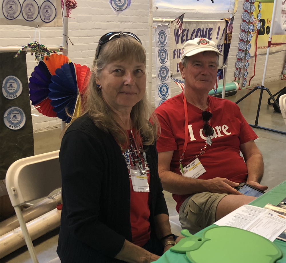 Mary & Rod Garges taking a turn at our info table.