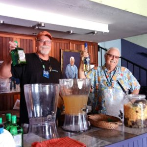 Two very popular volunteers, Tony Sparks, left, and Bob Petitt, mixed and served margaritas during the live auction at La Jolla Beach Camp during the 2018 Wine to Whales caravan. Photo by Joseph M. de Leon