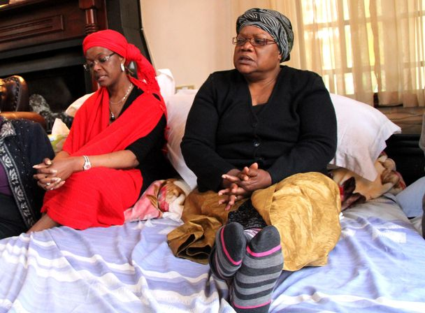 Joyce Mujuru mourning her husband, as grace looks on