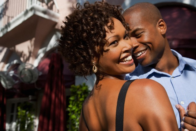 African American couple dancing outdoors