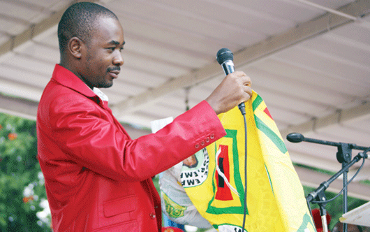 Nelson-Chamisa-show-MDCT-supporters-regalia-handed-over-by-former-Zanu-PF-suppoters-during-a-rally-at-Stanley-Sqaure-in-Bulawayo-on-Sunday-1