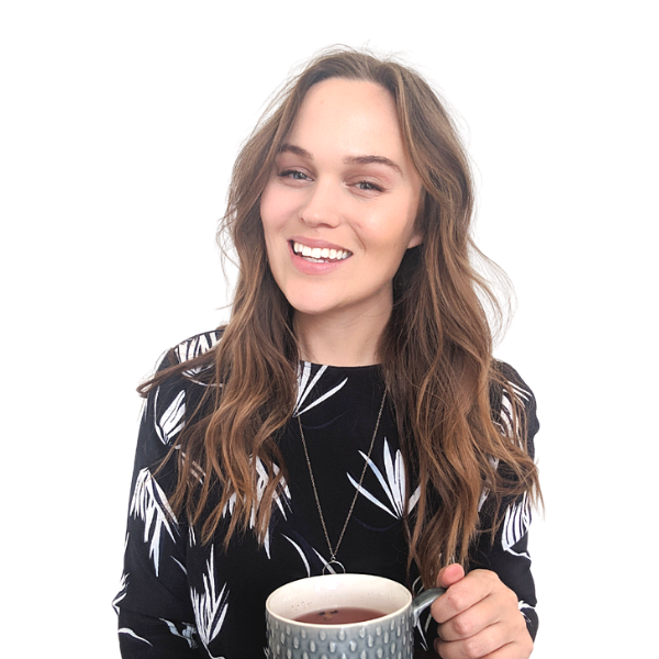 Career Coach Jessica Elliott smiling holding a coffee waiting for a client