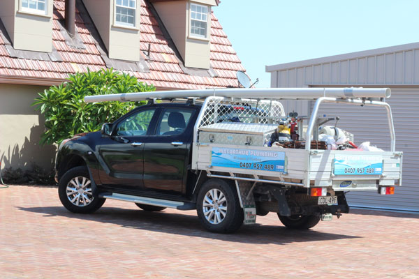 The Macarthur Plumbing work ute, loaded with plumbing tools.