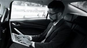 THINKLimo Executive working in car
