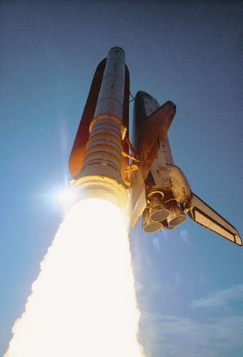 Space shuttle taking off.