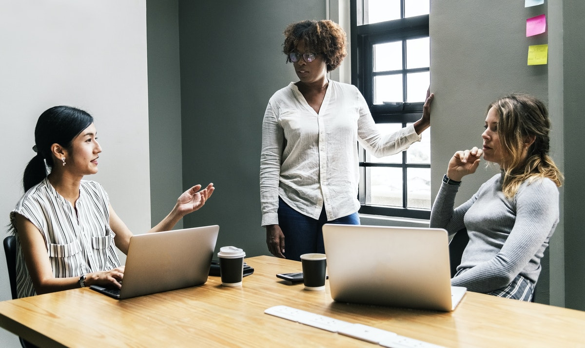 diverse women business meeting, how to choose a financial professional