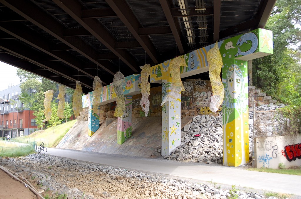 These hanging 'sculptures' are crafted from plastic barrier fencing. Chris Jones and Bud Shenefelt's creation titled Tissue: Permutations can be seen under the N. Highland Ave. overpass.