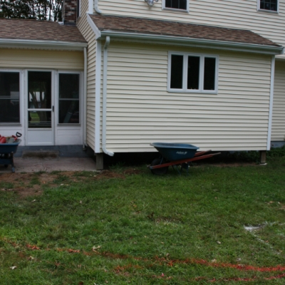 Before patio, firepit, and seating wall with piers 8