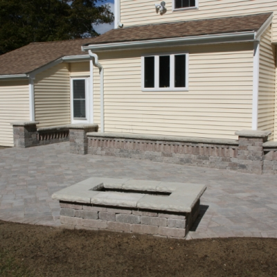 After patio, firepit, and seating wall with piers 8