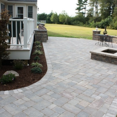 After patio, firepit, and seating walls with piers 9