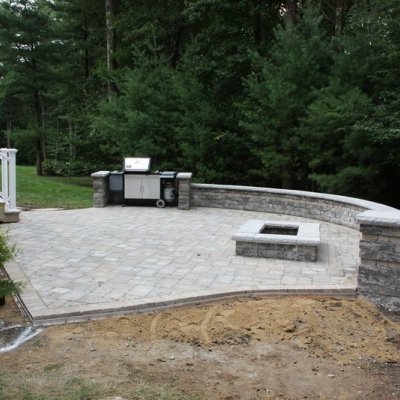 After patio, firepit, and seating wall with grill enclosure 1