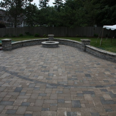 After large patio, firepit, and seating wall walls and piers 4