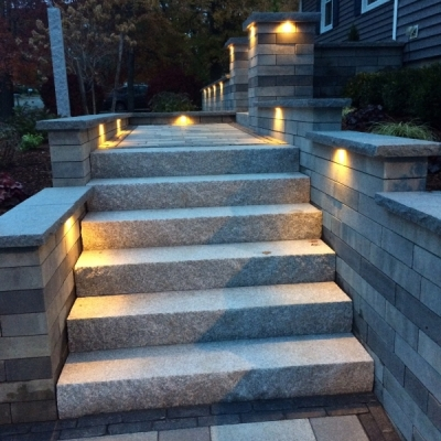 after granite steps, Lineo wall, with Blue Mist granite caps, Artline paver fiels with a Basalt Copthorne double border and lighting