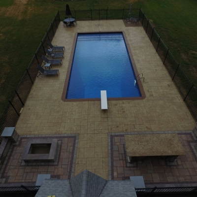 Outdoor Bar, Fire Pit, Grill Enclosure and Seating Wall with Piers with Low Voltage Lighting