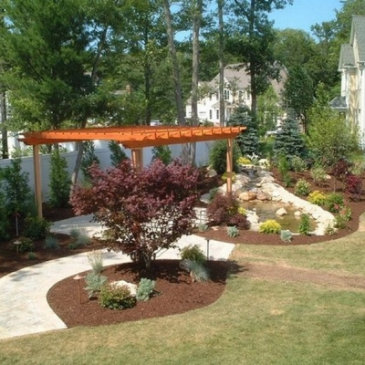Plantings, Walkway and Patio with Pergola using Brussels pavers 2 colors and double border