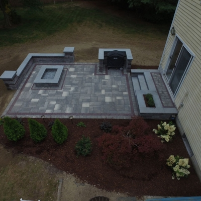 Back patio, seating walls, grill enclosure, fire pit