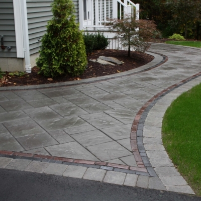 New York Beacon Hill Flagstone with a Basalt Copthorne and Burgundy Red Copthorne interior border and a New York Brussels paver exterior border