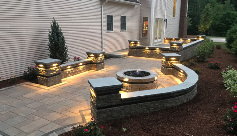 Whitmores Yard Care backyard living area with lighting