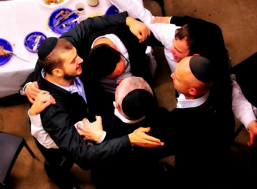Jews celebrating after a meal together