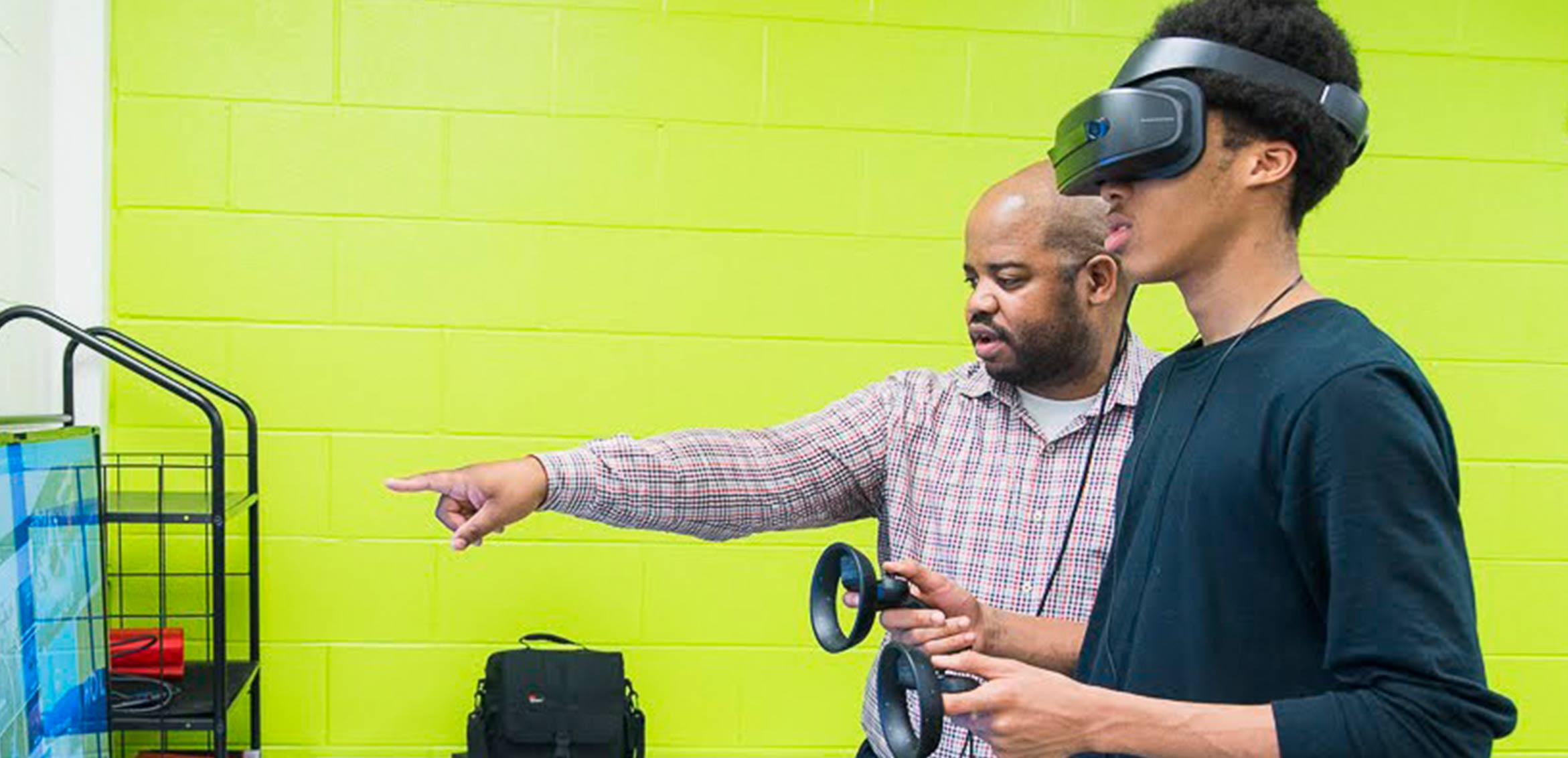 EX3 Team member with Dyett High School Student in VR headset