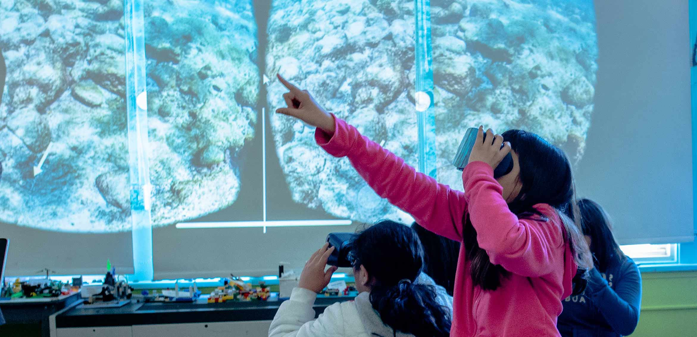 Student in virtual reality headset showing an underwater scene