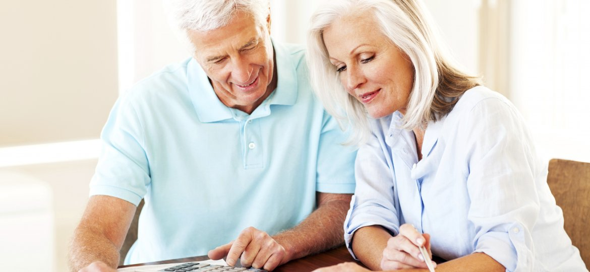 Senior Couple Calculating Financial Budget